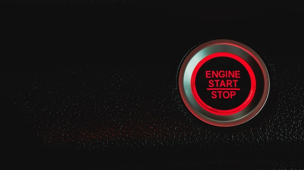 Druk op de start-knop en de motor in de auto.