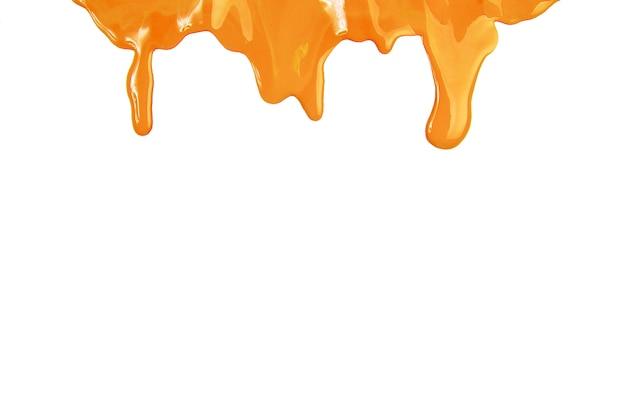 Druppels gele verf