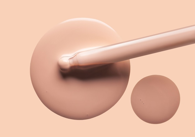 Druppels vloeibare make-up foundation met pipet textuur nude kleur