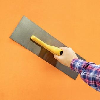 Drywall troffel tool op een geïsoleerde achtergrond
