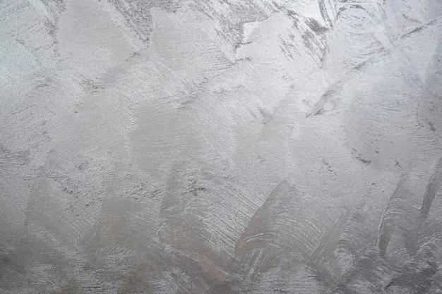 Duidelijke grijze glanzende achtergrondmuurtextuur