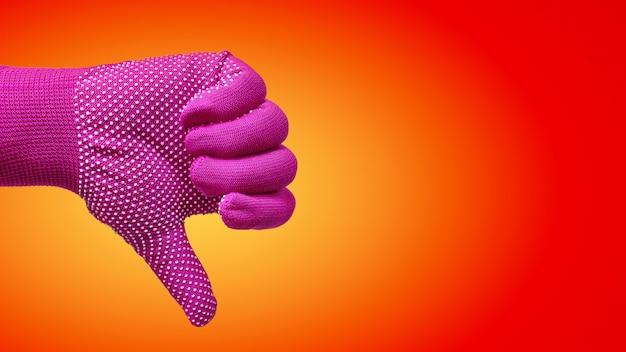 Duim omlaag handgebaar in handschoen geïsoleerd op rood