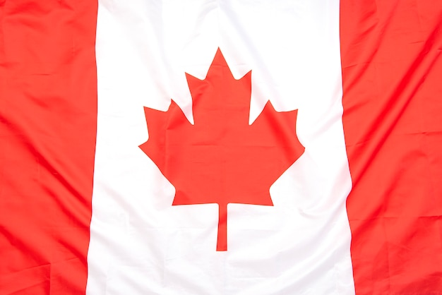 Echte stoffen vlag van canada als achtergrond of textuur, bovenaanzicht, canadese vlag