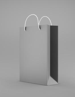 Eco verpakking mockup tas kraftpapier met handvat halve zijde. standaard middelgrote zwarte sjabloon op promotionele reclame op een grijze achtergrond 3d-weergave