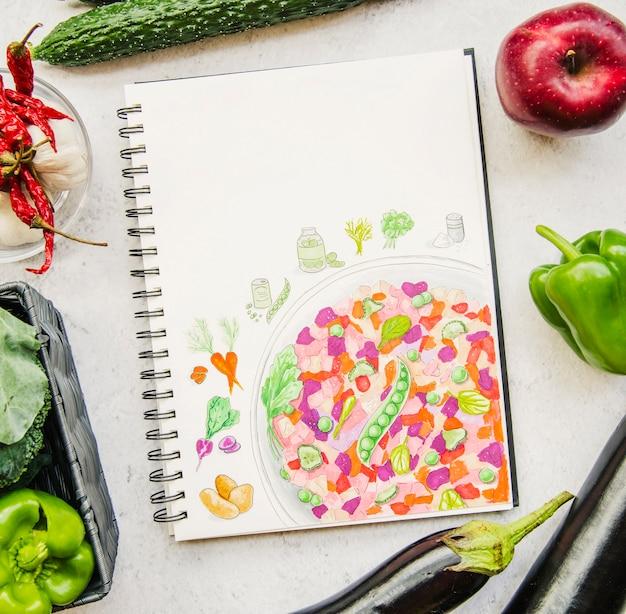 Een bovenaanzicht van een groente- en receptenboek