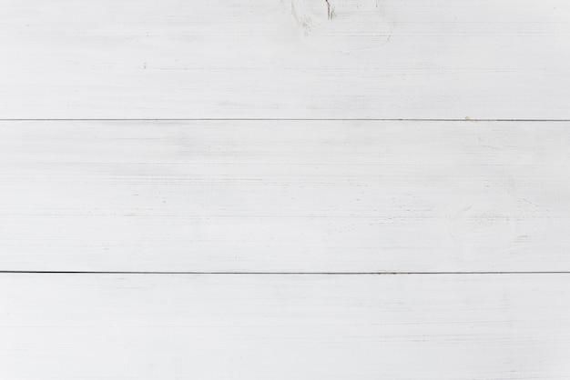 Een bovenaanzicht van houten witte plank achtergrond
