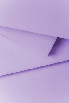 Een bovenaanzicht van paars papier textuur achtergrond