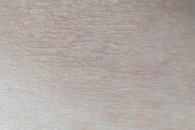 Een close-up macrotextuur van de menselijke blanke huid