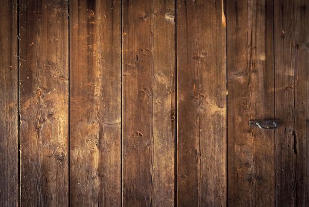 Een deel van de grote oude houten achtergrond van brede planken