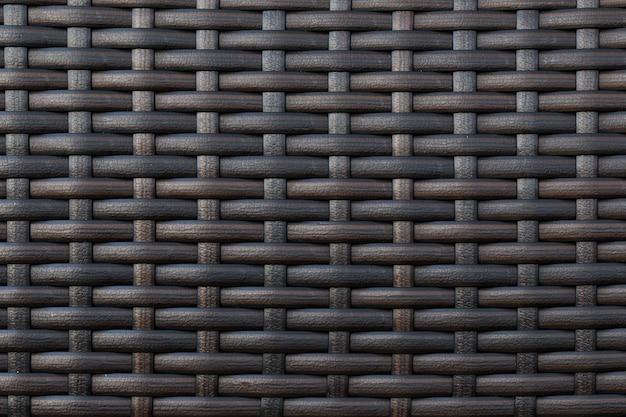 Een deel van het kunstmatige materiaal gevlochten donkere toon.