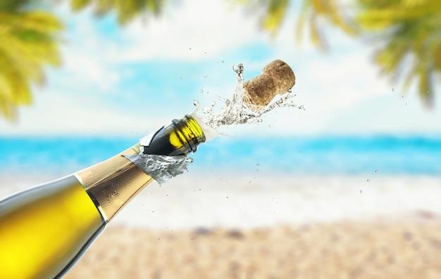 Een fles champagne openen op het strand