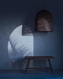 Een fragment van het interieur met een rieten lampenkap en een houten bankje en maanlicht aan de muur. 3d-weergave