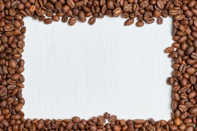 Een kader van de geroosterde achtergrond van koffiebonen