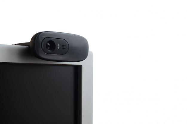 Een moderne webcamera is geïnstalleerd op het lichaam van een flatscreenmonitor. apparaat voor videocommunicatie en opname van video van hoge kwaliteit