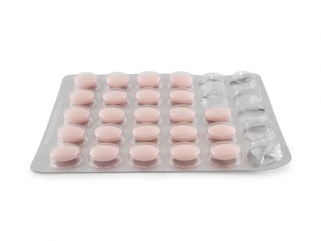 Een pakket roze pillen. pillen op wit