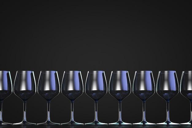 Een rij lege wijnglazen. donkere achtergrond. kopieer ruimte.