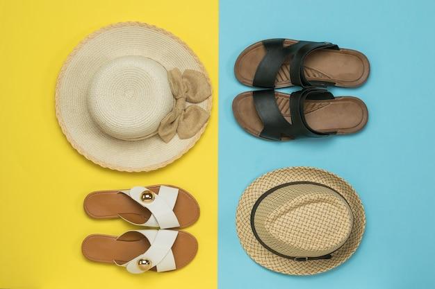 Een set zomerschoenen en -hoeden voor heren en dames. het concept van een familie zomervakantie.