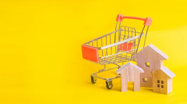 Een supermarktkar en huizen op een gele achtergrond.