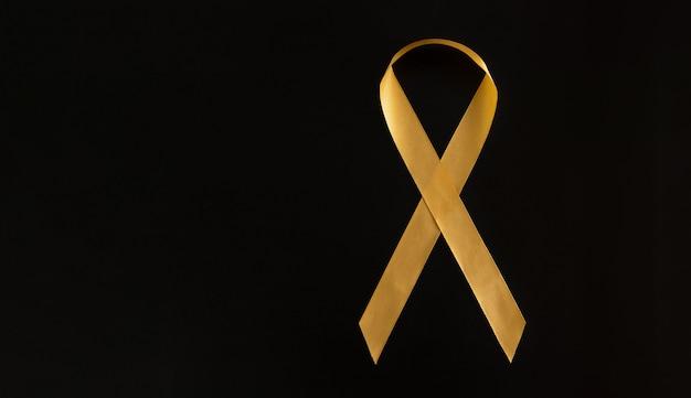 Een symbool van de strijd tegen kanker bij kinderen. ga babykanker goud. ruimte voor tekst