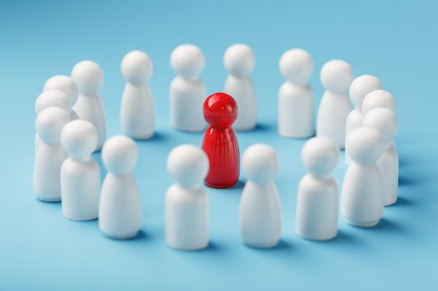Een team van blanken staat rond en luistert naar de leider van de rode leider. het concept van de leider van het zakelijke team.