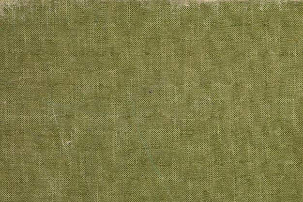 Een vintage stoffen boekomslag met groen schermpatroon