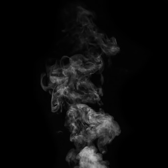 Een witte rook, rook op een zwarte achtergrond om toe te voegen aan je foto's. perfecte rook, stoom, geur, wierook voor uw foto's.