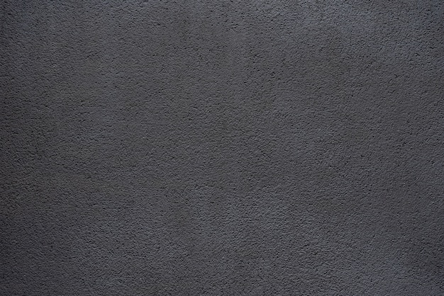 Eenvoudige achtergrond van zwart beton
