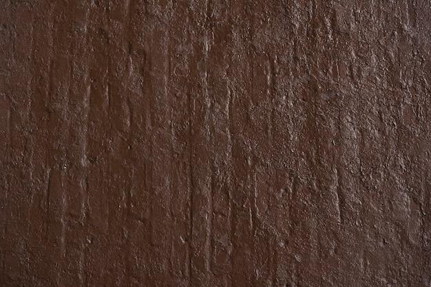 Eenvoudige bruine betonnen muurachtergrond