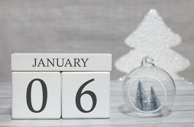 Eerste maand van het jaar, een kalender met cijfers en een maand, 6 januari. nieuwjaars sprookje als aandenken.