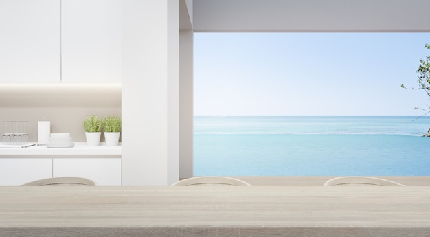 Eetkamer bij moderne keuken in luxe strandhuis.