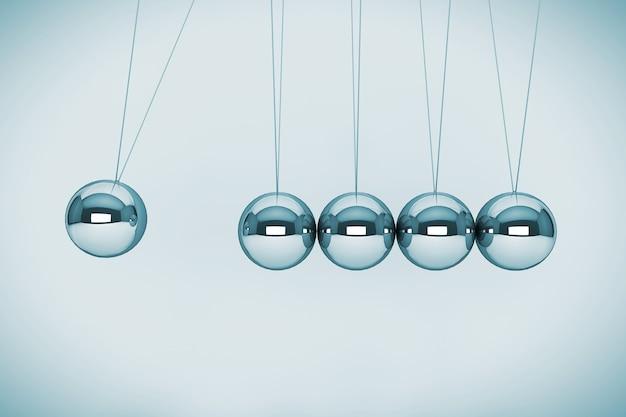 Eeuwigdurende bewegingsconcept. bollen van newton op een witte achtergrond