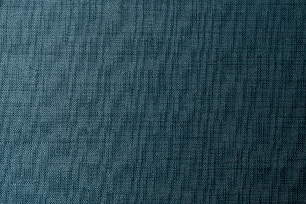 Effen donkerblauwe stof getextureerde achtergrond