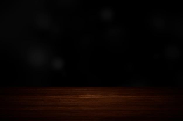 Effen donkere zwarte muur met houten vloer product achtergrond