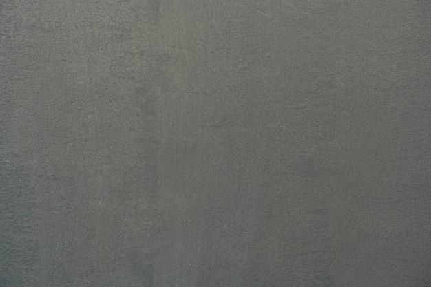 Effen donkergrijs cementstructuur