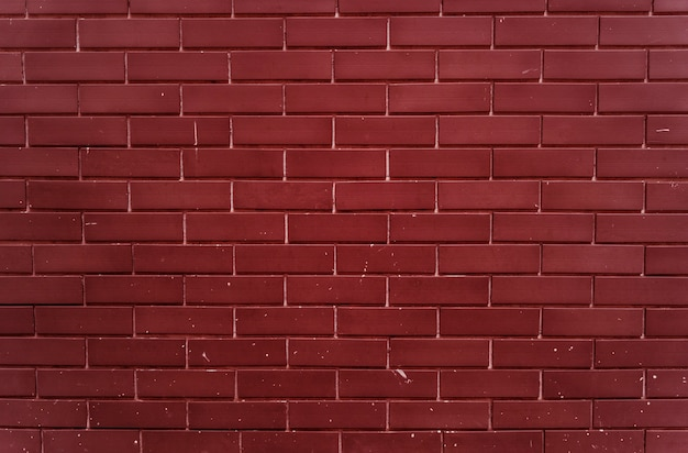 Effen felrode bakstenen muur
