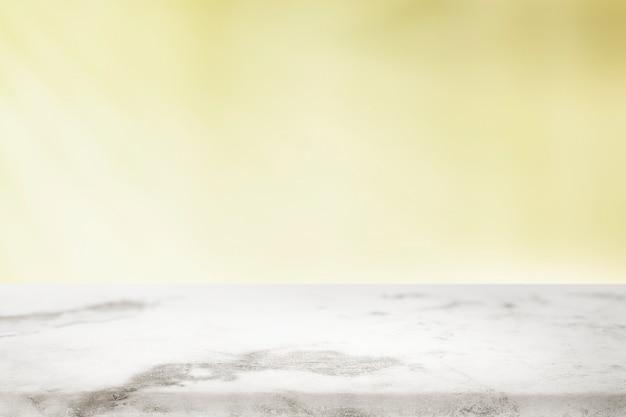 Effen gele achtergrond met wit marmer