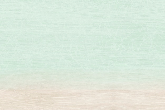 Effen pastelgroen met beige houten productachtergrond