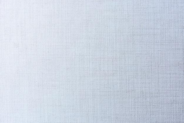 Effen vervaagde blauwe matte geweven stof getextureerde achtergrond