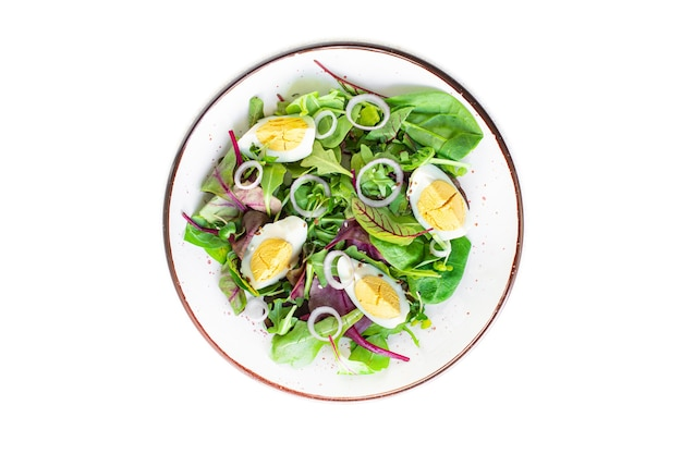 Eiersalade groenten verse groene bladeren mix spinazie rucola sla eieren gekookt biologisch voedsel