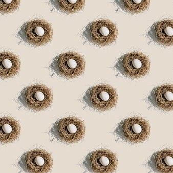 Eipatroon in het nest met een harde schaduw op een beige achtergrond pasen in de stijl van pop-art