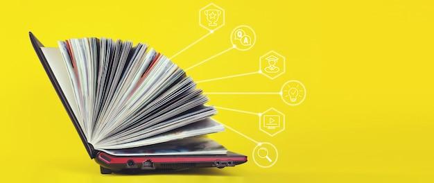 Elearning concept - laptop als boek op gele achtergrond. kennisbankconcept. Premium Foto
