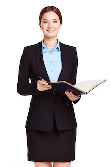 Elegant zakenvrouw herziening van de agenda