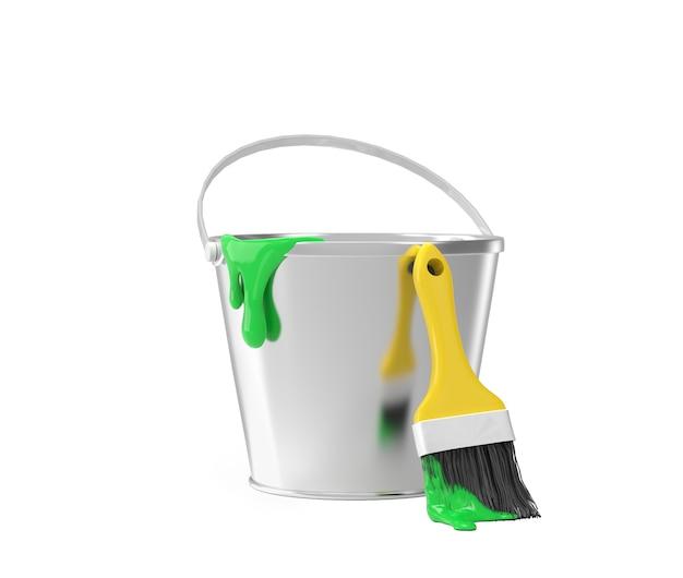 Emmer met groene verf en penseel