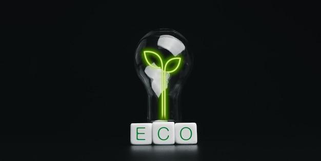 Energiebesparende, milieuvriendelijke conceptbanner. creatief gloeiend groen blad in de gloeilamp en eco, woorden op witte dobbelstenen blokken geïsoleerd op een donkere achtergrond.