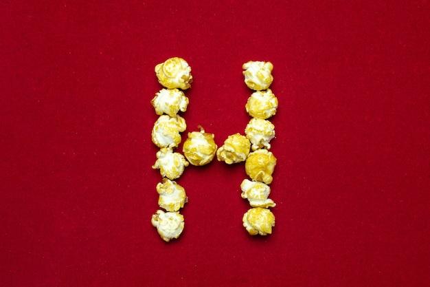 Engels alfabet van bioscooppopcorn. brief h.