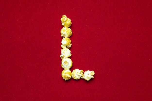 Engels alfabet van bioscooppopcorn. letter l.