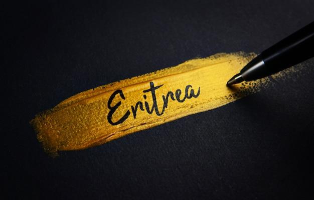 Eritrea handschrifttekst op gouden verfpenseelstreek