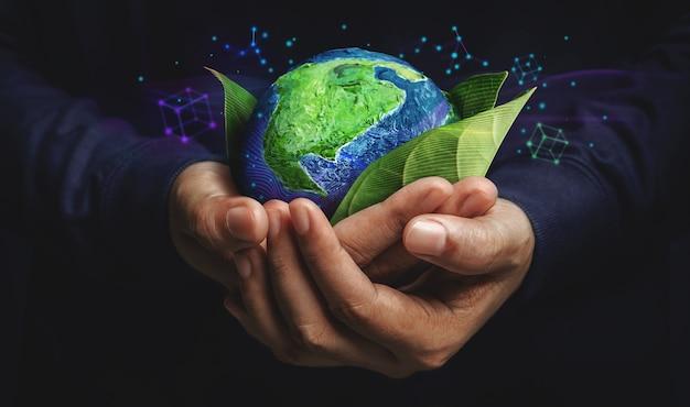Esg-concept. natuur ontmoet technologie. groene energie, hernieuwbare en duurzame hulpbronnen. milieu- en ecologiezorg. hand die groen blad en wereldbol omarmt