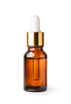 Essentiële serumolie in amberkleurige fles met gouden dop en witte druppelaar