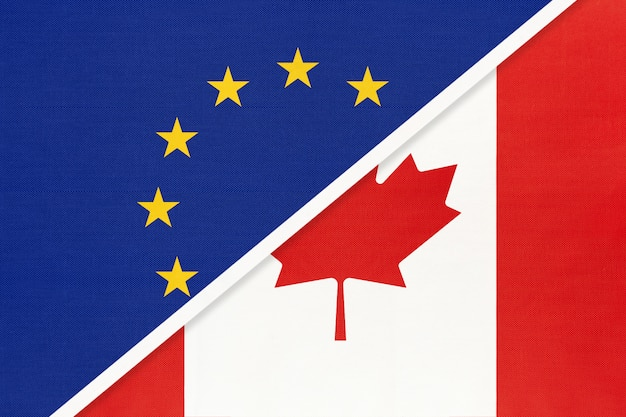 Europese unie of eu versus canada symbool van nationale vlag van textiel.